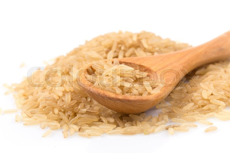 Stock image of 'brown rice over the spoon on a white background'