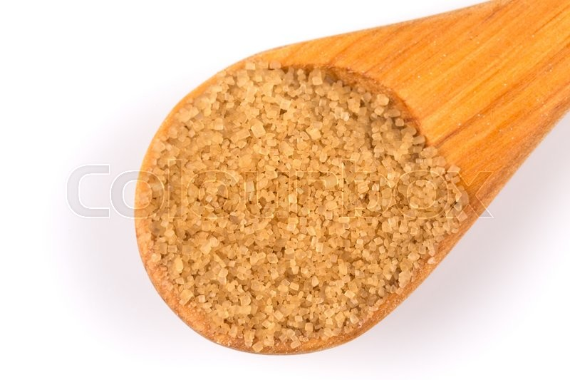 Stock image of 'brown sugar in a wooden spoon on white background'