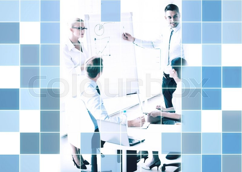 Stock image of 'business, strategy and people concept - business people with graph on flip board at presentation in office  over blue squared grid background'