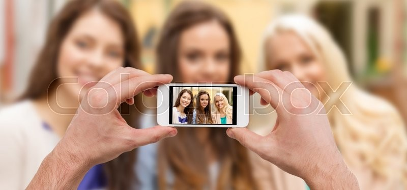 Stock image of 'holidays, electronics and tourism concept - close up of man hands taking picture with smartphone camera'