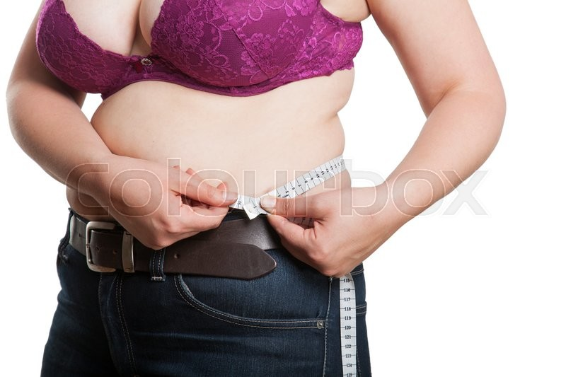 Stock image of 'Overweighted woman measure her body circumfences with a white measuring tape'