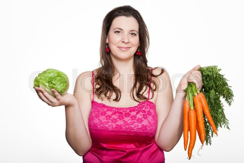 Stock image of 'Overweighted woman with lettuce and carrots'