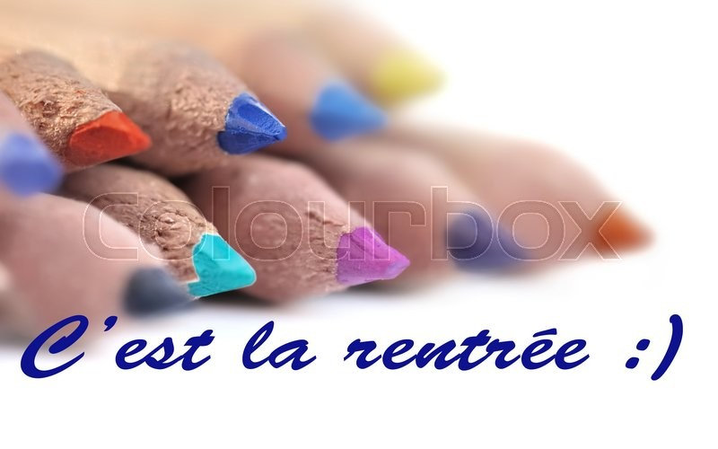 Stock image of 'Back to school in french  on background color pencil leads'