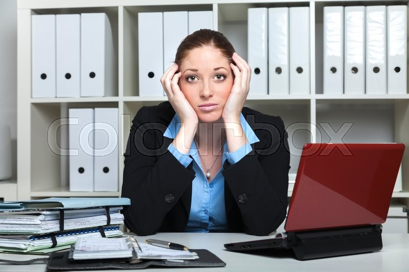Stock image of 'Businesslady with in hopeless situation recongizes her bad income'