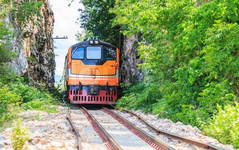 Stock image of 'Train and tours train running  past tunnel  kanjanaburi,Thailand'