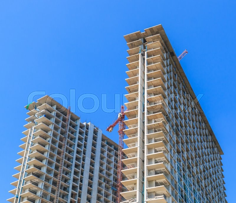 Stock image of 'Construction site with cranes'