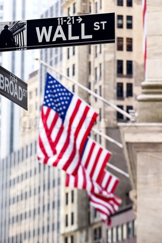 Stock image of 'Wall street sign in New York with New York Stock Exchange background'