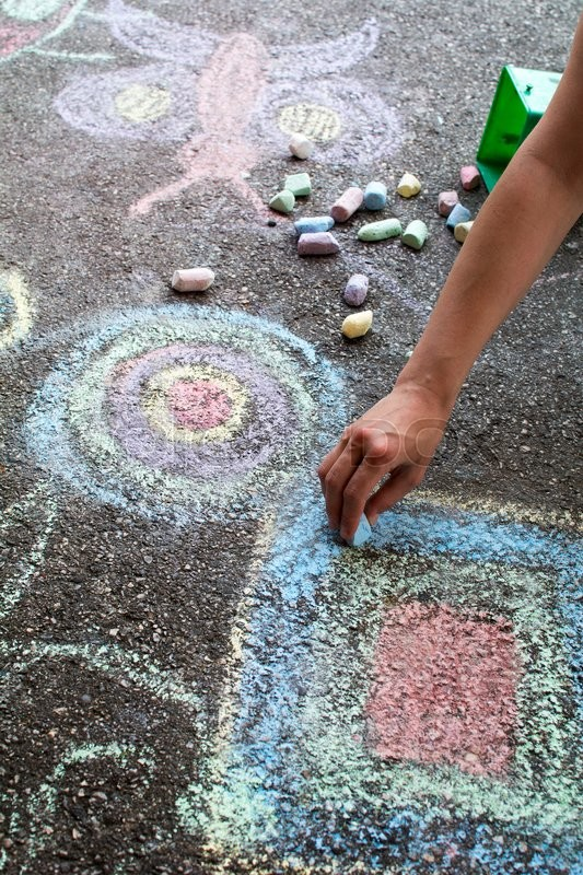 Stock image of 'Chalk drawing hand outside on asphalt, woman hand..'