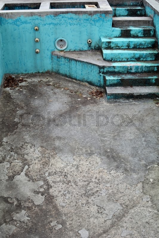 Stock image of 'Empty swimming pool needs some maintenance.'