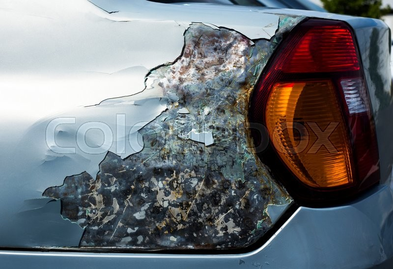 Stock image of 'Rusty and unprotected car metal from side view.'