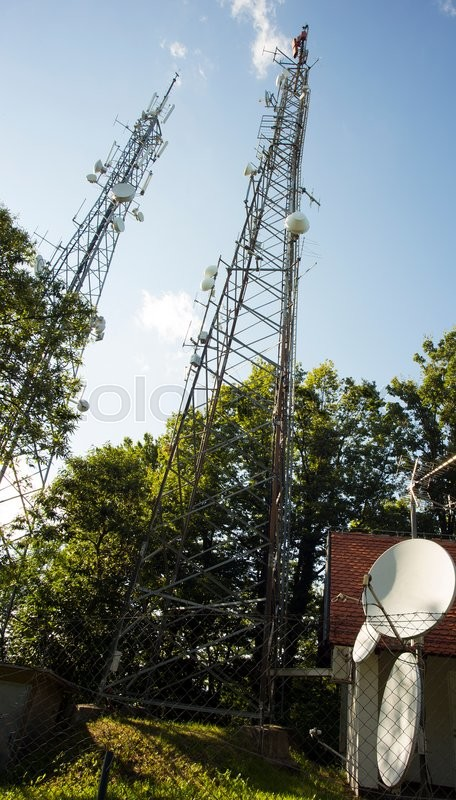 Stock image of 'Telecommunication mobile antenna, a low angle view'