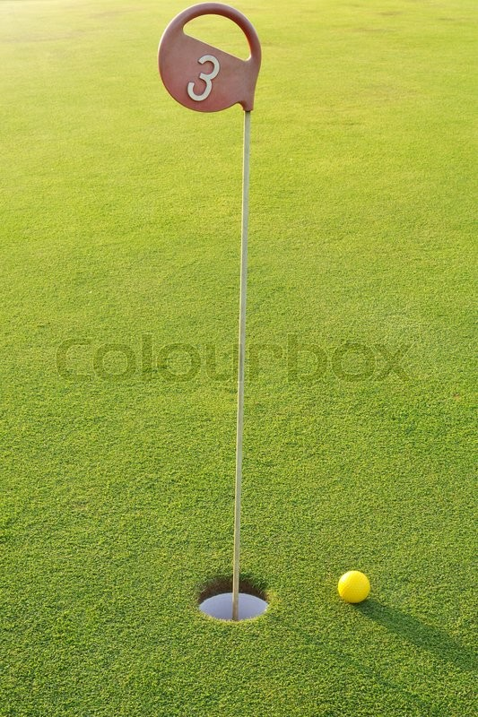Golf hole number 3 in a sunny weather, stock photo