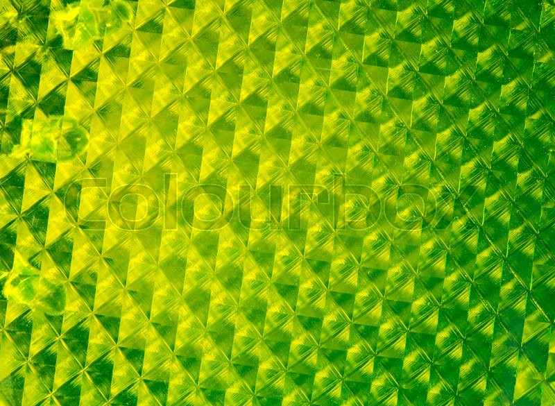 Stock image of 'Green pedestrian reflector texture with a gradient.'