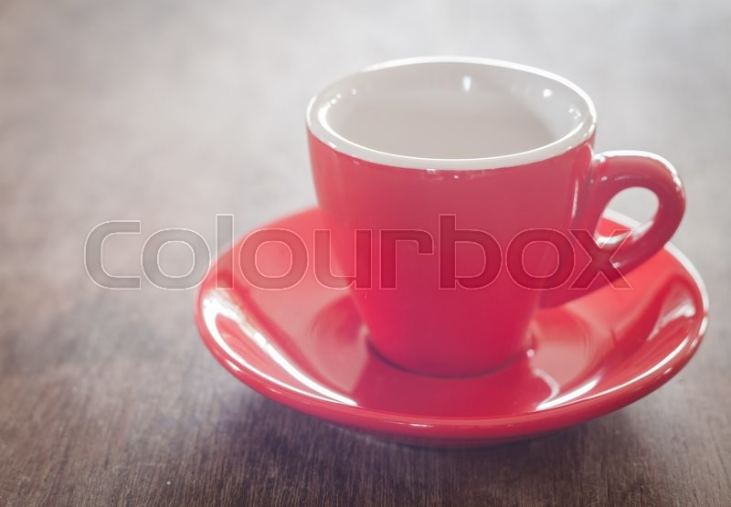 Stock image of 'Red coffee cup on wooden table, stock photo'