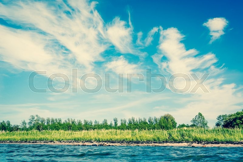 Stock image of 'Ocean shore in Scandinavia with blue sky in the summer'