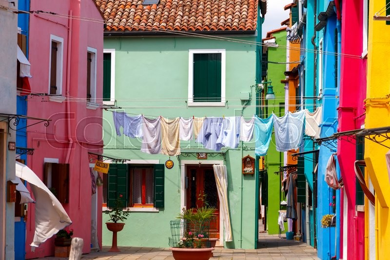 Stock image of 'Venice, Italy - May 21, 2015: The island in the lagoon near Venice. Famous tourist attraction. Famous for its colorful houses and lace.'