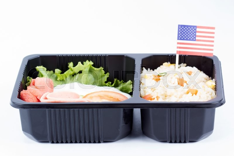 Stock image of 'Fried Rice with Egg Ham and Sausage in meal box'
