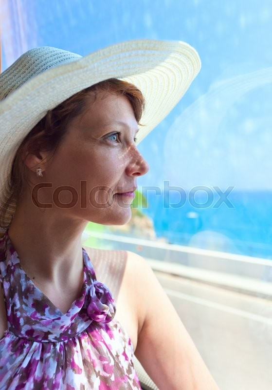 Stock image of 'The woman in the bus looks out of the window '