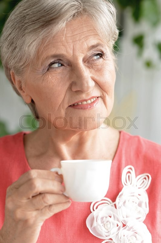 Stock image of 'Portrait of senior woman with cup of coffee'