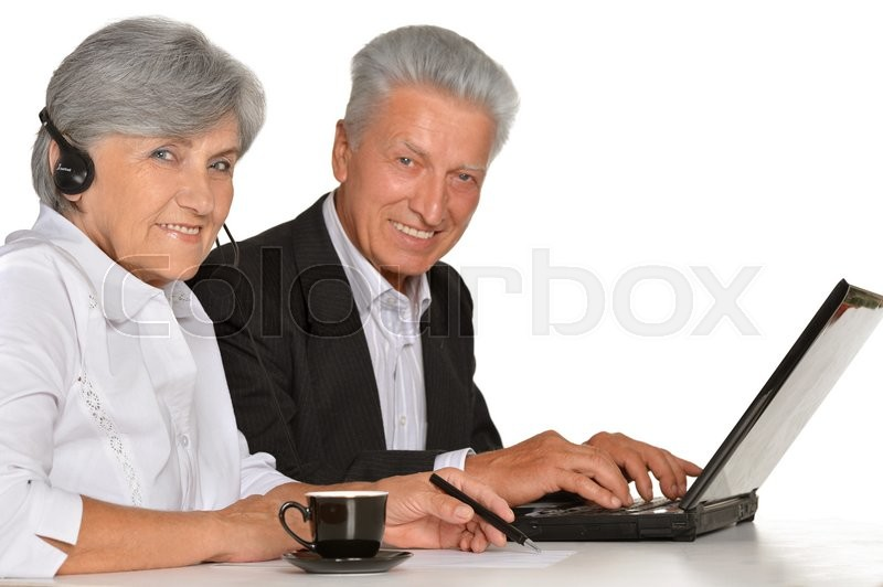 Stock image of 'Portrait of two elderly people working with laptop on white background'