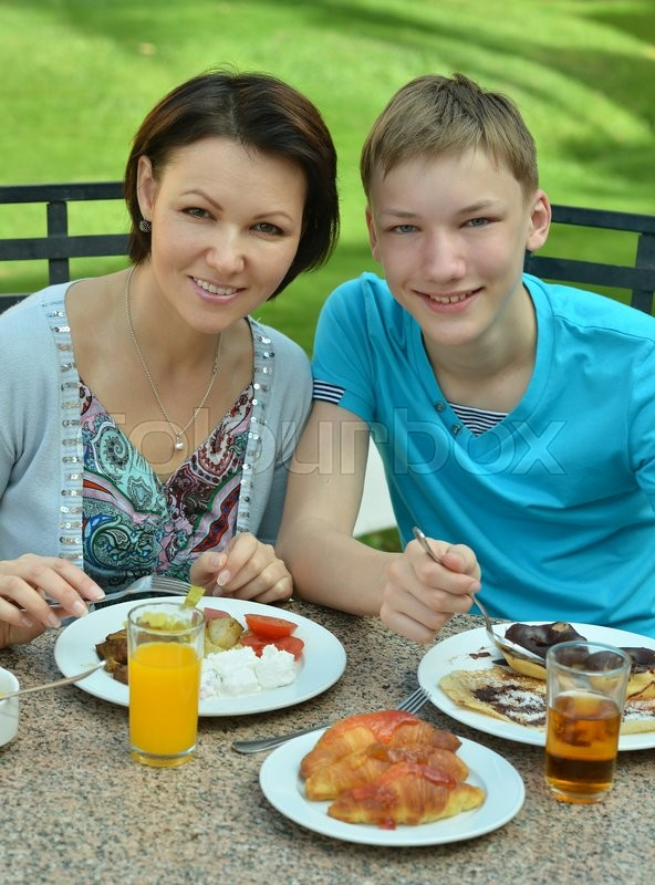 Stock image of 'Happy mother and son at breakfast on the table'