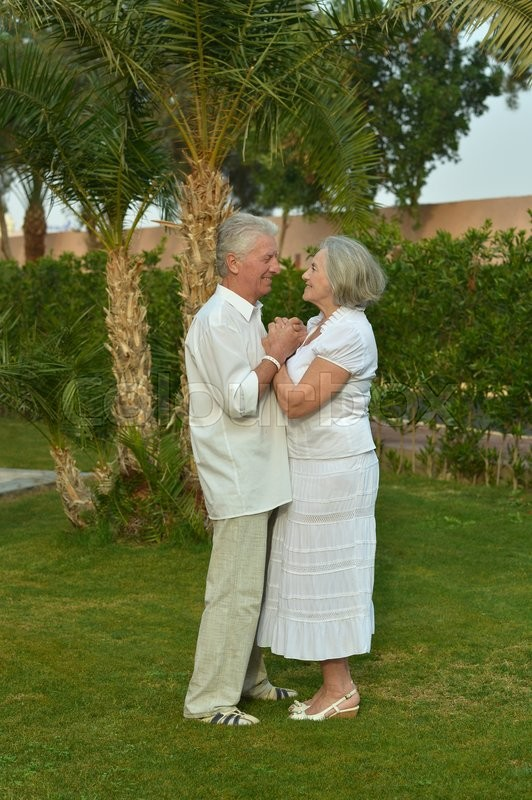 Stock image of 'Portrait of amusing smiling senior couple on vacation'