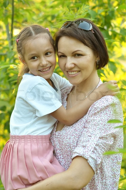 Stock image of 'Little cute girl with her mother in summer park'