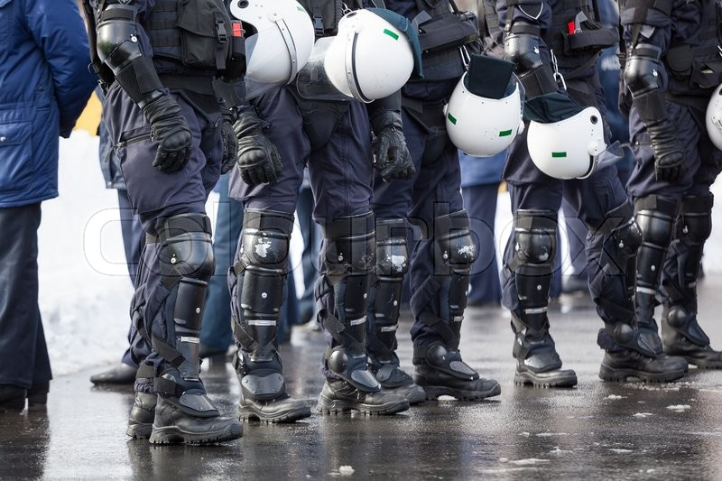 Stock image of 'Riot Police unit waiting for orders'