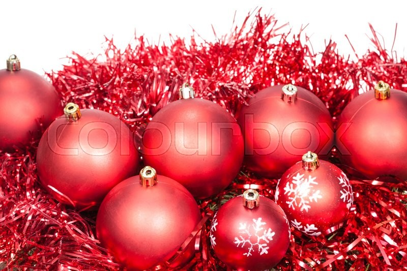 Stock image of 'several red Christmas baubles and tinsel isolated on white background'