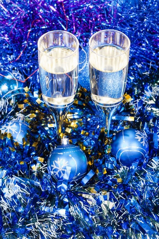 Stock image of 'Christmas still life - above view of two glasses of champagne in blue Xmas balls and tinsel'