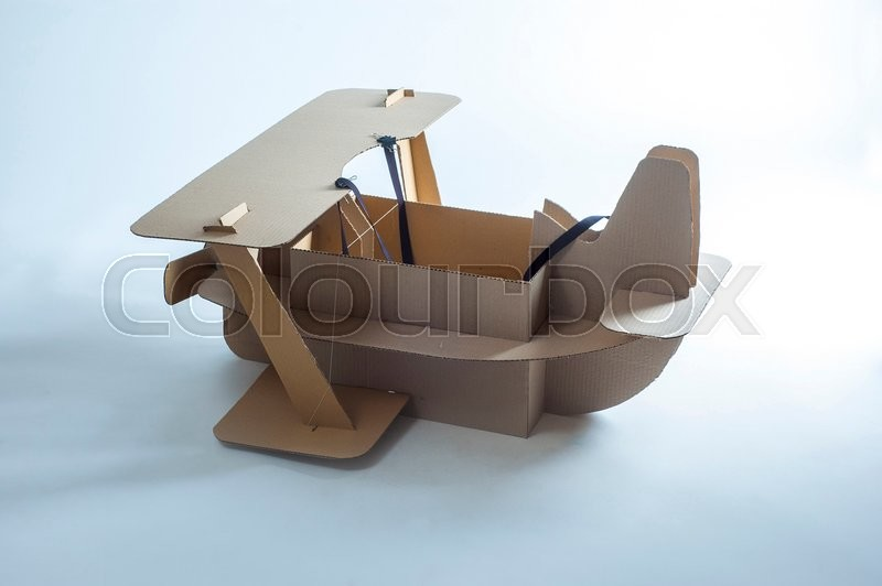 Stock image of 'Photo of  cardboard plane on white background. Biplane.'