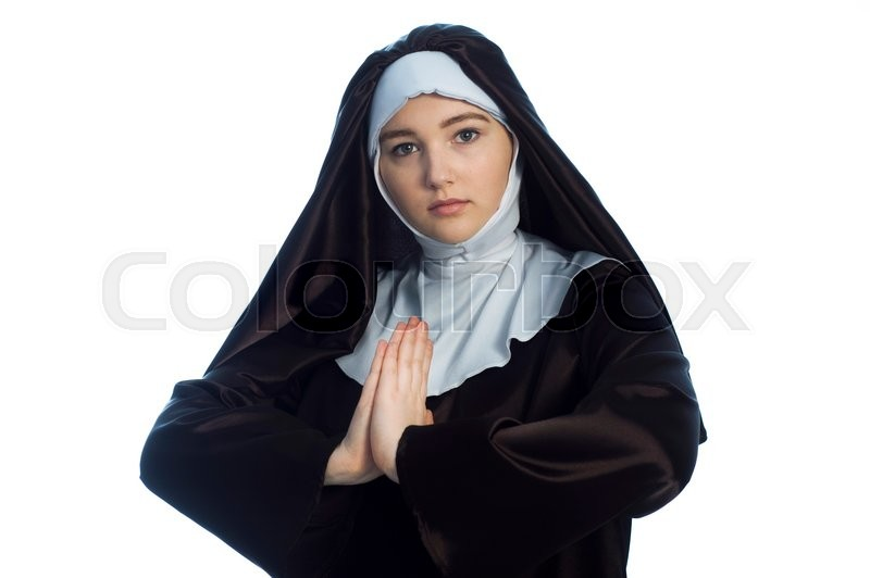 Stock image of 'Young nun prays. Photo on white background. '