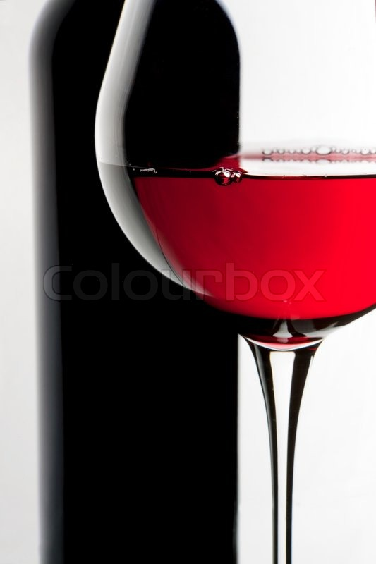 still life with bottle and glass of red wine over white background stock photo bottle red wine