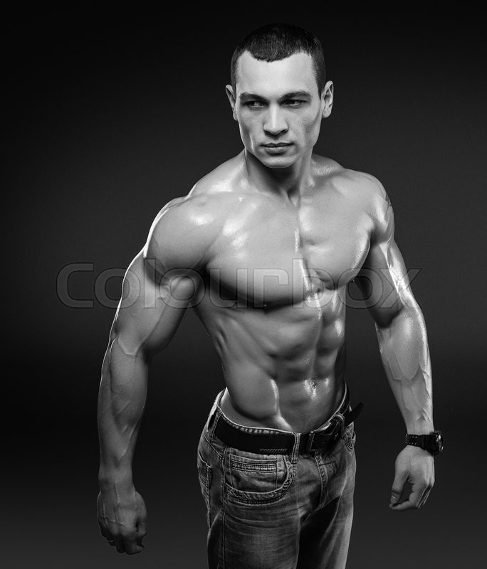 Stock image of 'Beautiful muscular male model with nice abs in jeans with copy space. Clipping path included.'