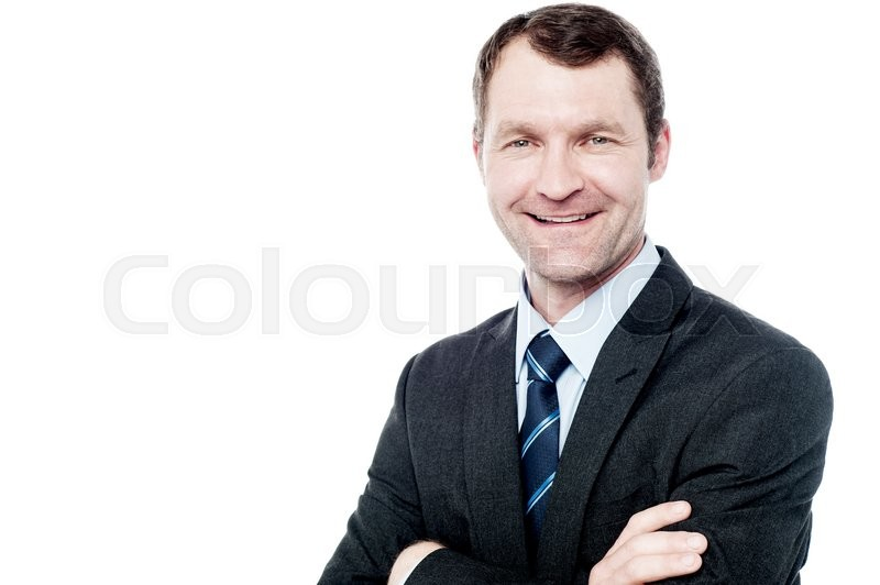 Stock image of 'Successful businessman posing with folded arms'