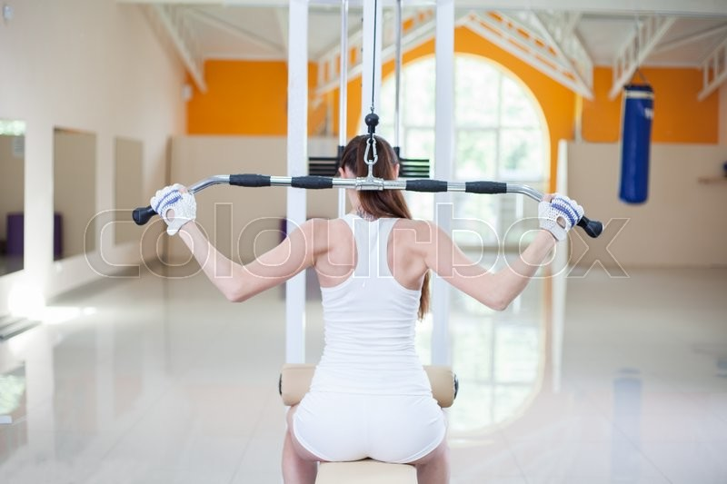 Stock image of 'girl is doing exercises at the gym'