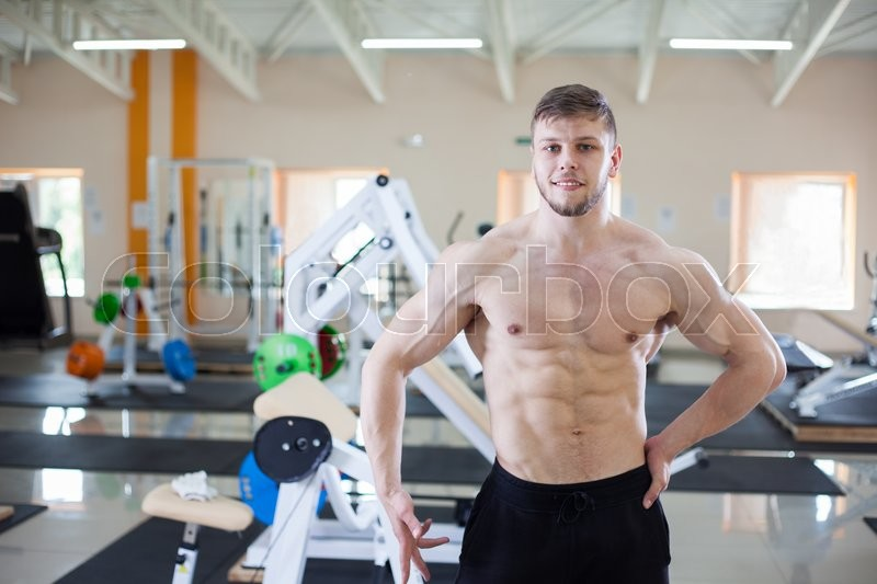 Stock image of 'Muscular man in the gym centre'