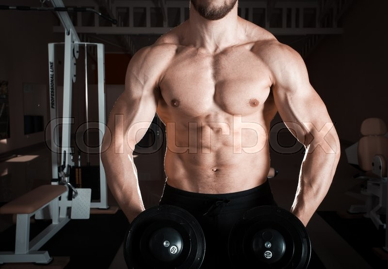 Stock image of 'Closeup of a muscular young man lifting weights'