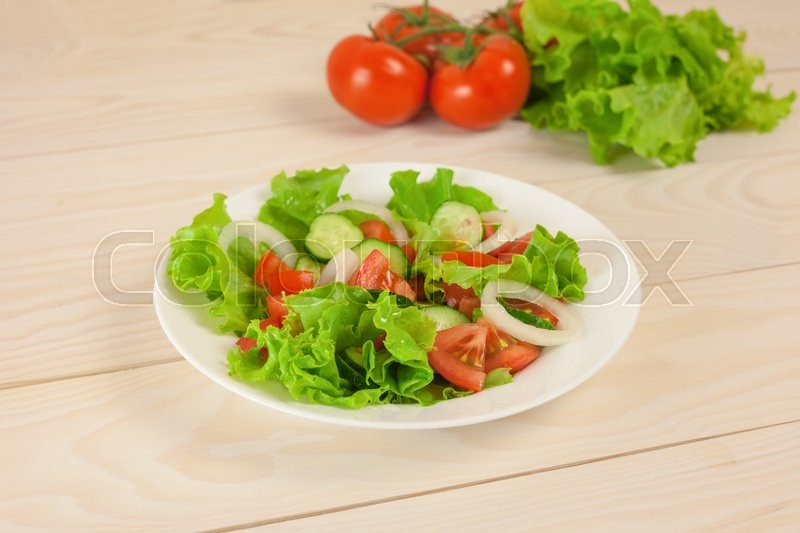 Stock image of 'fresh salad on wooden table'