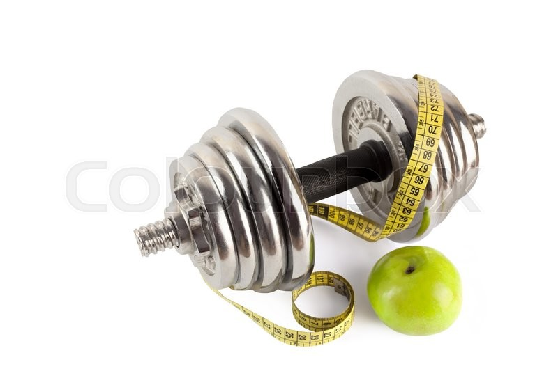 Stock image of 'barbell with meter and apple isolated on wite'