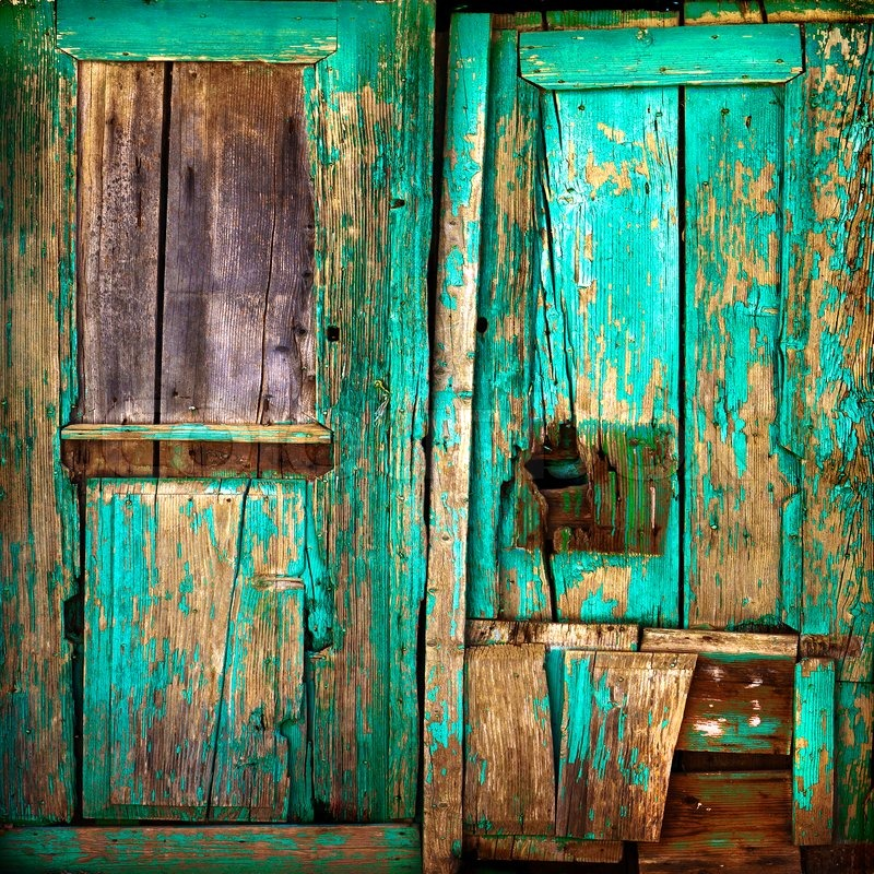 Top Old wooden door. Old painted wooden boards. Old paint. Background  WI99