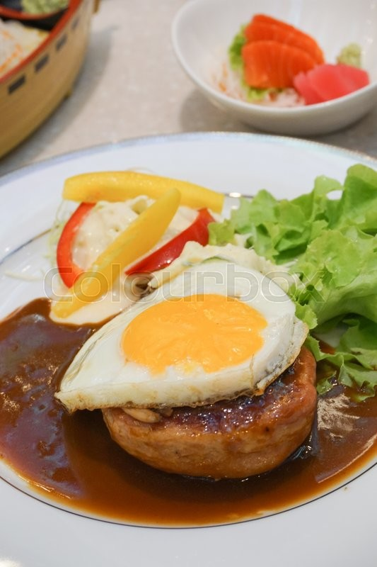 Stock image of 'Beef Hamburg steak with egg. Hamburg , Japanese Hamburger.'