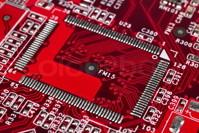 Stock image of 'red electronic circuit board with microchip, close up'