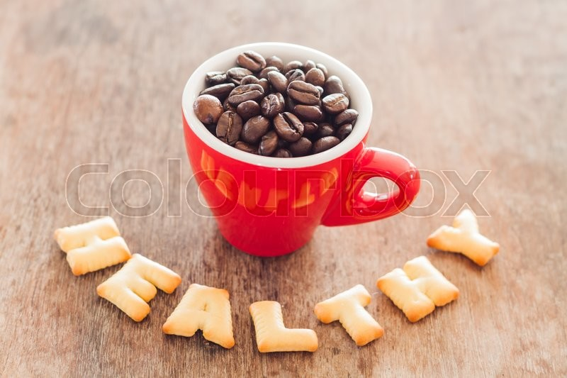 Stock image of 'Healthy alphabet biscuit with red coffee cup alphabet biscuit with red coffee cup, stock photo'