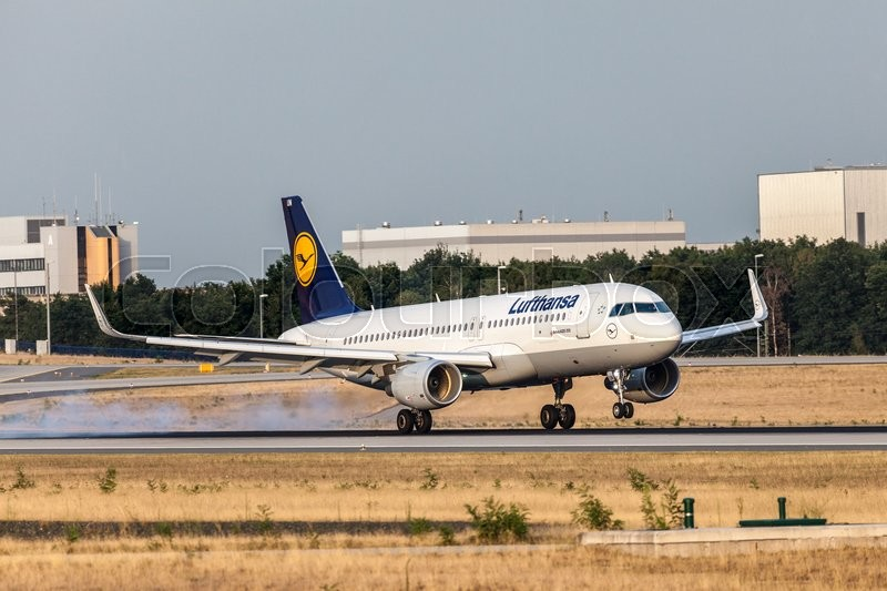 Editorial image of 'FRANKFURT, GERMANY - JULY 18: Lufthansa Airbus A320-200 aircraft landing at the Frankfurt International Airport. July 18, 2015 in Frankfurt, Germany'