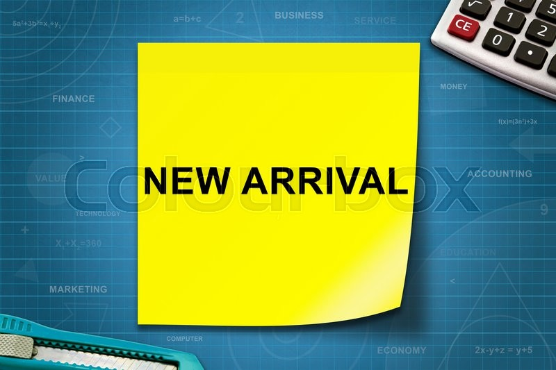 Stock image of 'new arrival text on yellow note with graph paper'