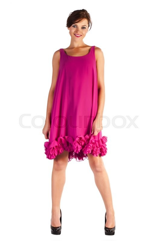 Stock image of 'Young and sexy woman model in pink dress and black shoes with heels posing'