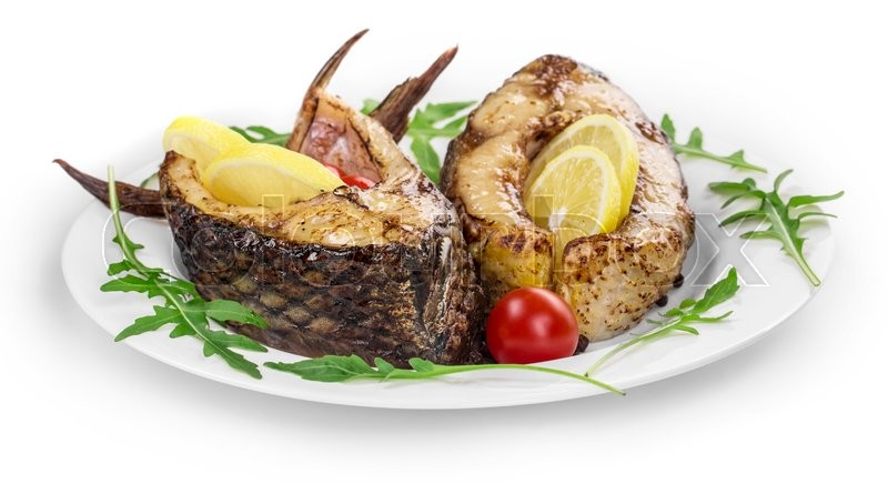 Stock image of 'Close up of grilled carp steak. Isolated on a white background. '