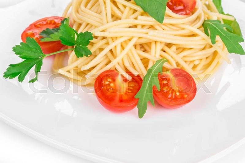 Stock image of 'Italian pasta with tomatoes. Isolated on a white background. '