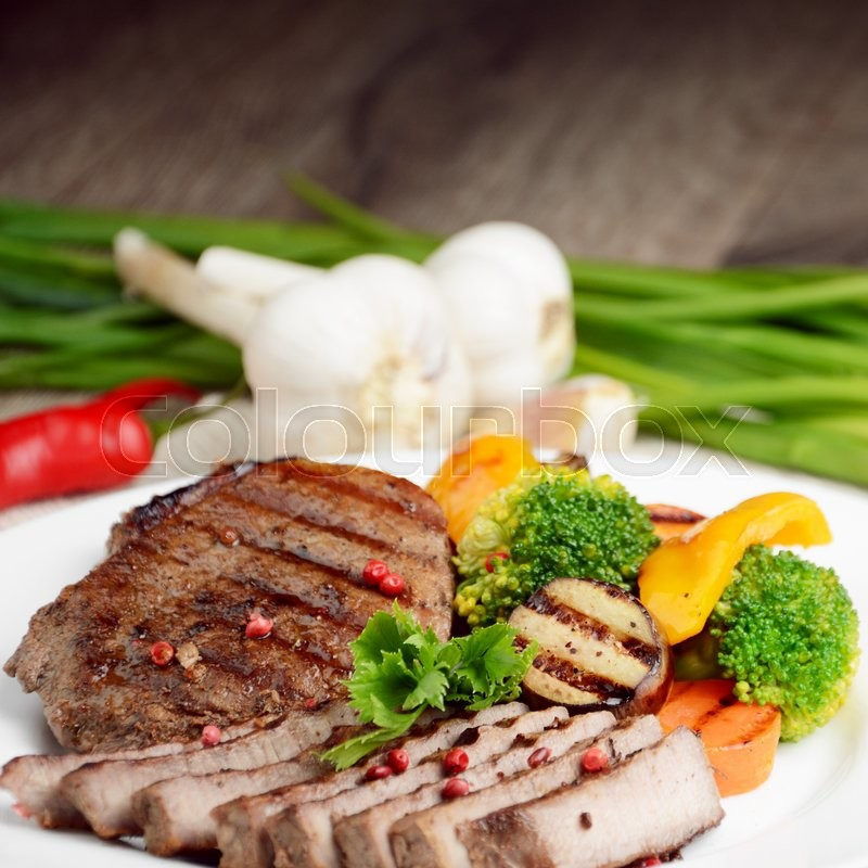 Stock image of 'Delicious  hot grilled beef steakes on the table'